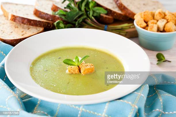 Pea and mint soup with basil and croutons