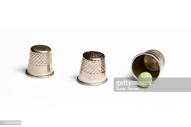 pea and thimble trick - shell game stock photos and pictures