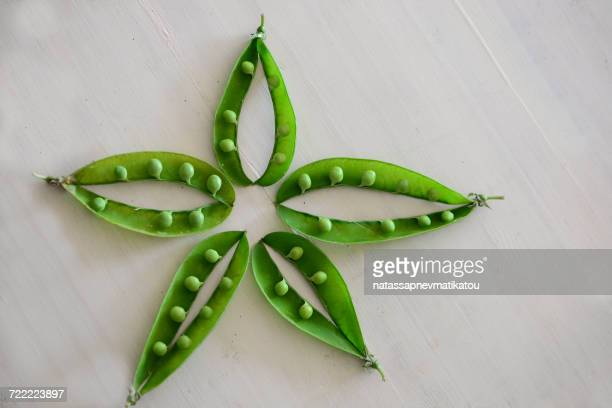 Pea pods arranged in a star shape