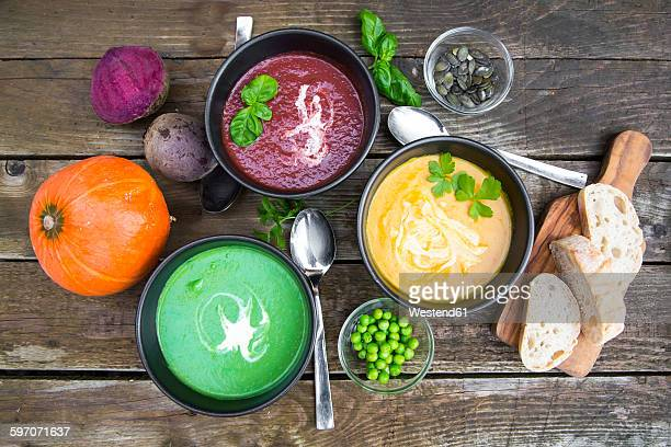 Pea soup, beetroot and pumpkin soup in bowls