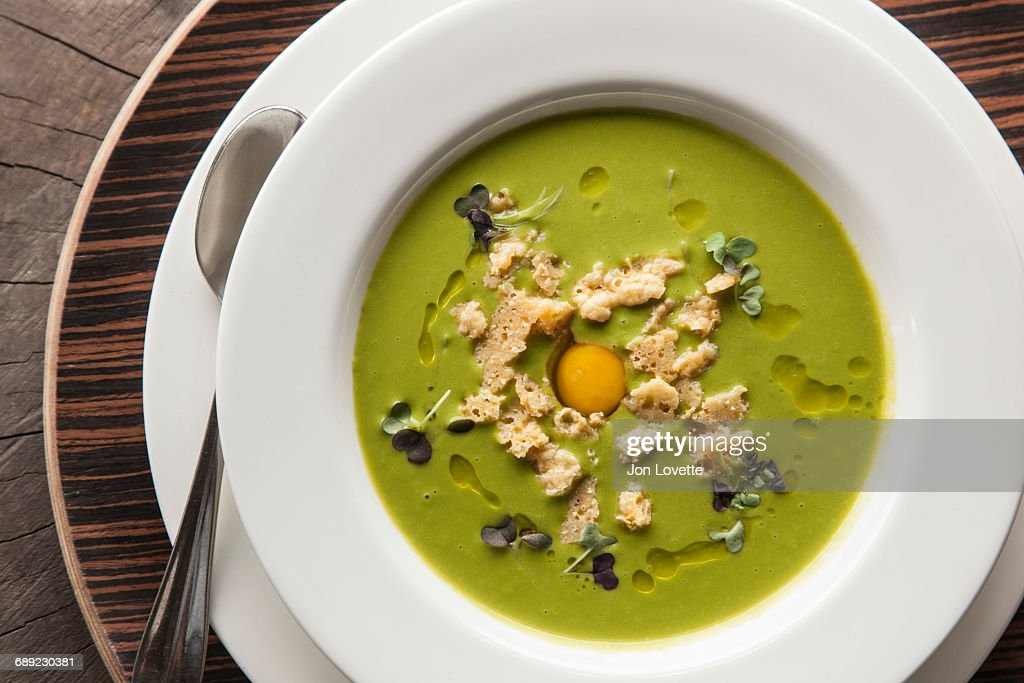 Pea Soup with a fresh egg : Stock Photo