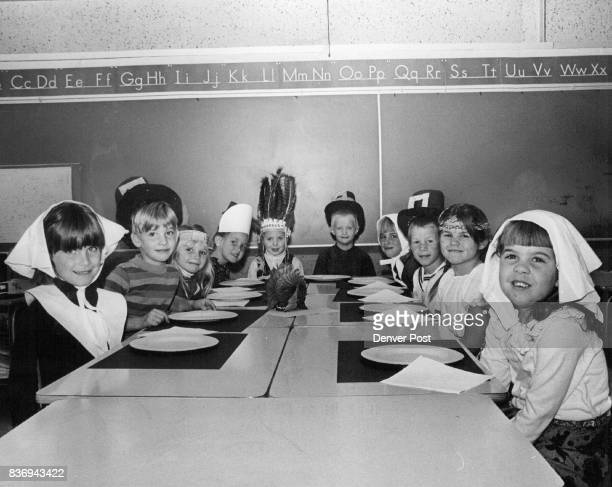 Peabody Elementary School Children Sit Around Thanksgiving Table Dressed in appropriate costumes they are from left Ann Kottler Vern Church Tonie...