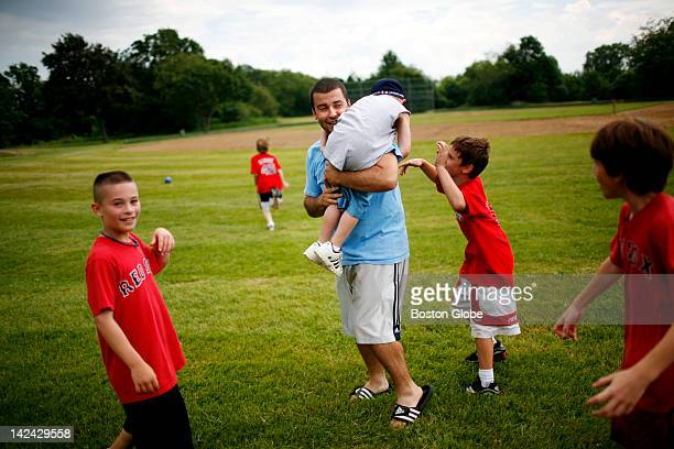 Peabody Recreation Department supervisor Matt Mello takes a hostage as he tries to round up all of the loose balls after a 'Duck Dive and Dodge'...