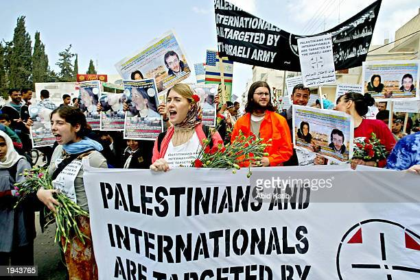 Peace activist members of the International Solidarity hold banners and posters of their friends US citizen Rachel Corrie and British citizen Tom...