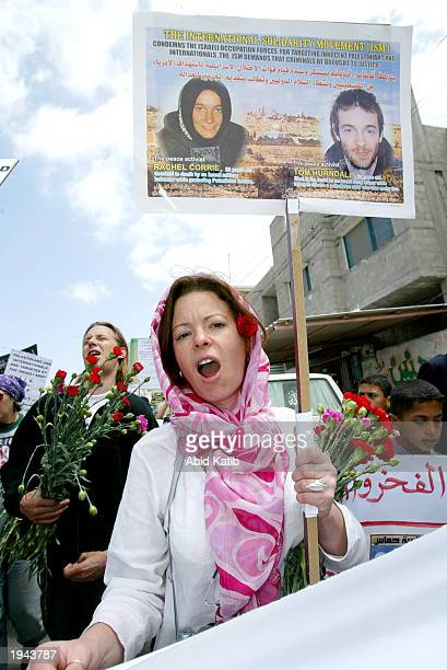 Peace activist members of the International Solidarity hold banners and posters of their friends US citizen Rachel Corrie 23 and British Tom Hurndall...