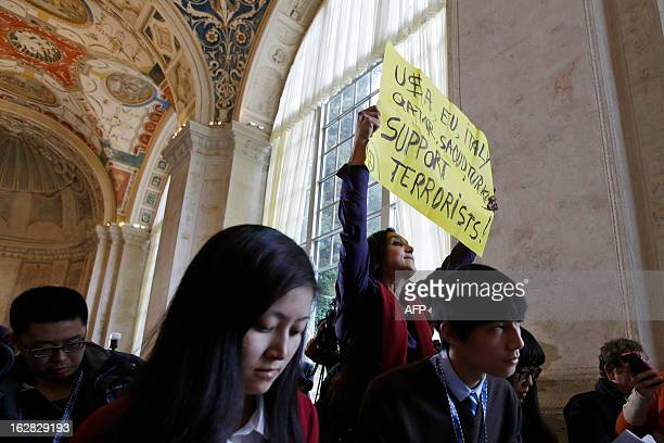 A peace activist who would not give her name protests what she said is the killing of innocent civilians by countries including the US and Italy at...