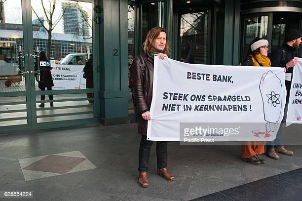 Peace activists march to several banks in Brussels KBC BNP Paribas Fortis ING and Deutsche Bank to protest against their involvement in nuclear...