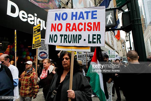 Peace activists take part in a rally and march protesting Donald Trump and war on March 13 2016 in New York City The Trump campaign cancelled a...