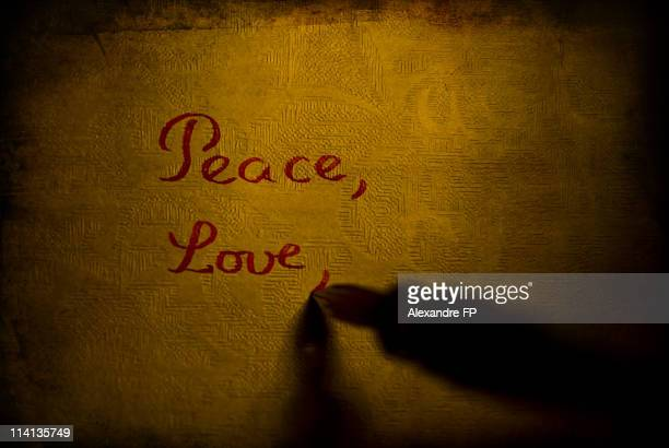 """""""Peace"""" and """"Love"""" words written with glass pen"""