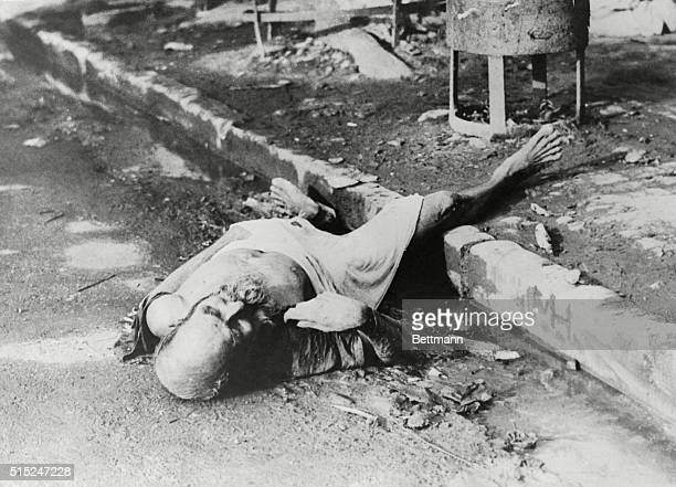 Peace at Last. Calcutta: In the famine that has spread throughout India, the toll of dead rises steadily in this photo, a body of an old man, starved...