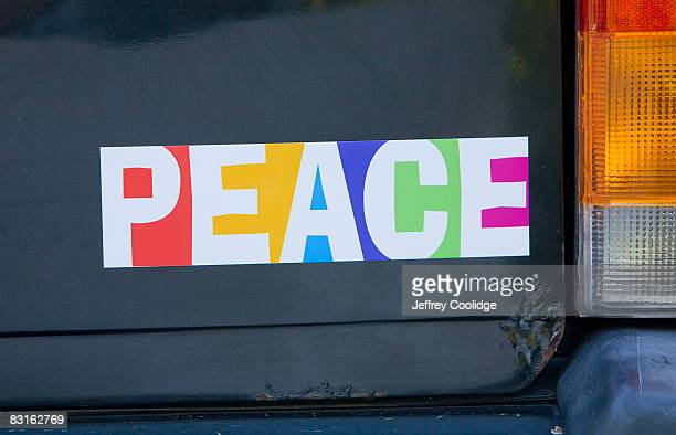 peace bumper sticker on car - bumper sticker stock photos and pictures