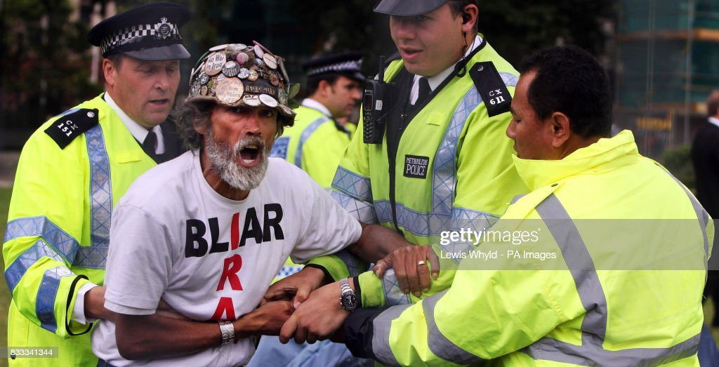Peace campaigner Brian Haw with police after letters were issued to campers asking them to leave Parliament Square after claims that they have 'overstepped the mark'.
