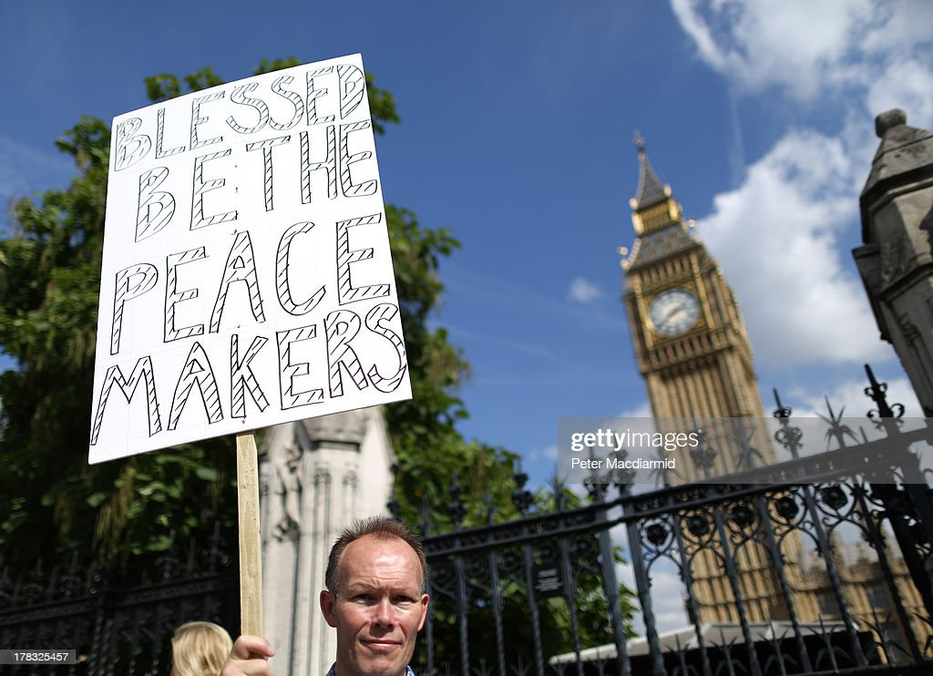 A peace campaigner stands outside Parliament on August 29, 2013 in London, England. Prime Minister David Cameron has recalled Parliament to debate the UK's response to a suspected chemical weapon attack in Syria.
