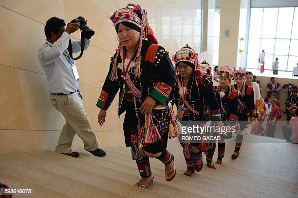 Peace conference delegates from the Akha ethnic group from eastern Shan State wearing traditional costume adorned with silver ornaments arrive for...