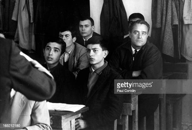 Peace Corps founder and president Sargent Shriver sits with students in an English class taught by a volunteer Akhisar Turkey 1964