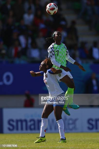Peace Efih of Nigeria wins a header from Danielle Etienne of Haiti during the FIFA U20 Women's World Cup France 2018 group D match between Haiti and...