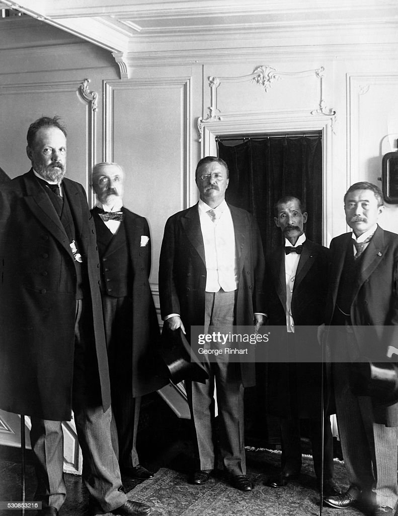 Peace envoys of Russia and Japan including (left to right) Count Sergei Witte; Baron Rosen; President Theodore Roosevelt; Marquis Jutaro Komura; and Minister of War Takahira aboard the Mayflower.