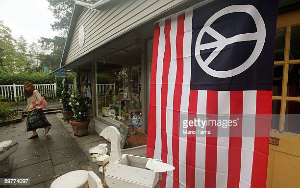 A peace flag hangs in front of a building the 40th anniversary of the Woodstock music festival approaches August 13 2009 in Woodstock New York On...