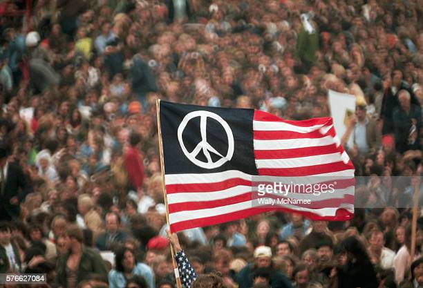 A peace flag version of the American flag flies during a Vietnam War protest in Washington DC