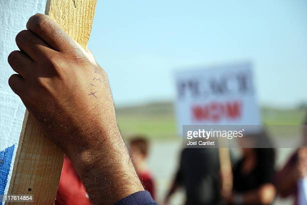 hand of protest at israel-gaza border - peace demonstration stock photos and pictures