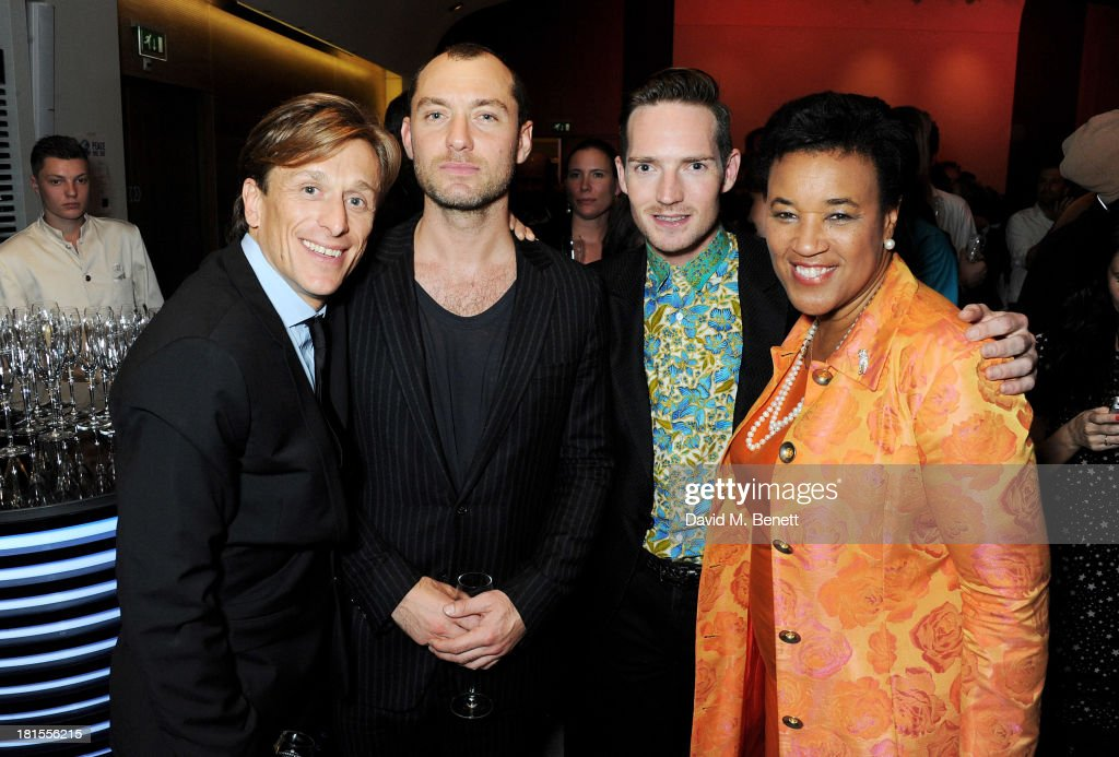 Peace One Day founder Jeremy Gilley, Jude Law, Dan Gillespie Sells and Baroness Patricia Scotland celebrate 'Peace One Day' at the Peace One Day concert after party held at the Hilton on September 21, 2013 in The Hague, Netherlands.