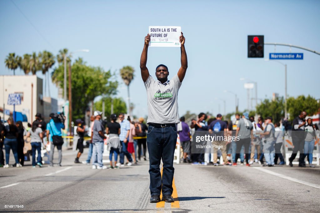Peace rally participant, Dennis Ojogho (22), stands for a portrait at the intersection of Florence and Normandie, on the 25th anniversary of the LA riots, on April 29, 2017 in Los Angeles, California. Florence and Normandie was the flashpoint for the riots that was sparked by the police acquittals in the Rodney King beating.
