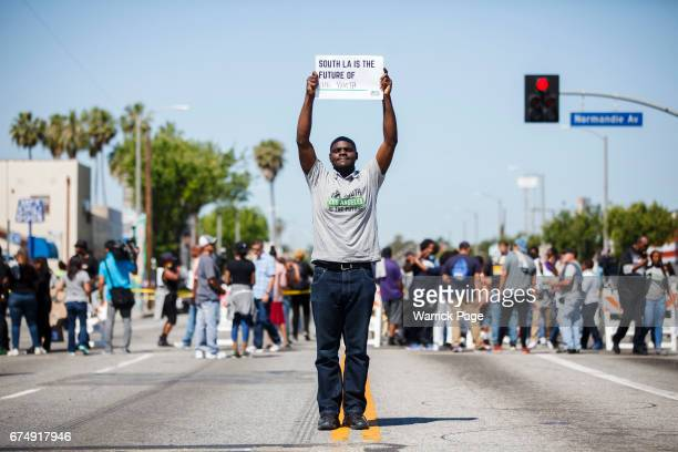 Peace rally participant Dennis Ojogho stands for a portrait at the intersection of Florence and Normandie on the 25th anniversary of the LA riots on...
