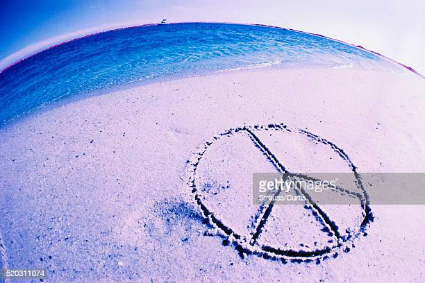 Peace Sign Drawn in Beach Sand