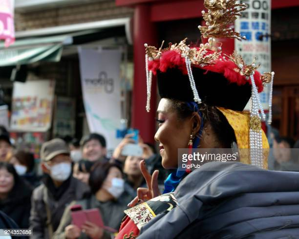 Peace sign from empress at Chinese New Year parade 2018 in Yokohama Chinatown