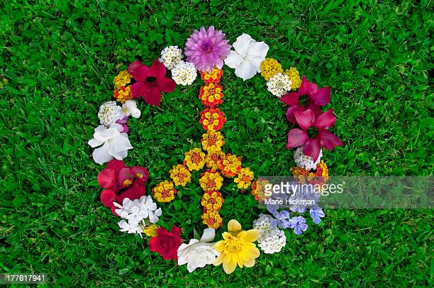 Peace sign made with many flowers on grass