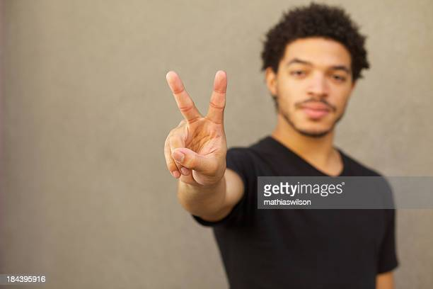 peace sign - peace symbol stock photos and pictures