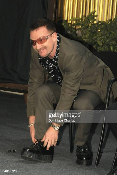 Peace Summit Award Laureate and U2 lead singer Bono attends the 9th Nobel Peace Prize World Summit at Hotel de Ville on December 12 2008 in Paris...