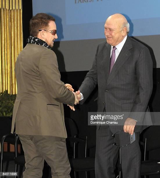 Peace Summit Award Laureate and U2 lead singer Bono greets 1993 Nobel Peace Prize Winner Fredrik Willem De Klerk during the 9th Nobel Peace Prize...