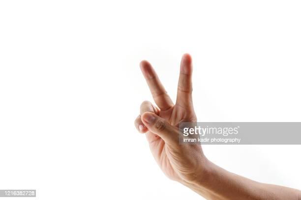 peace symbol from finger on white background - número 2 fotografías e imágenes de stock