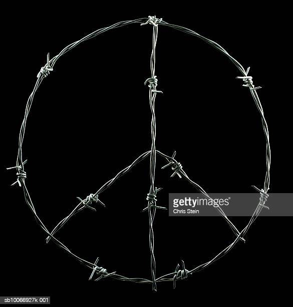 Peace symbol made of barbed wire