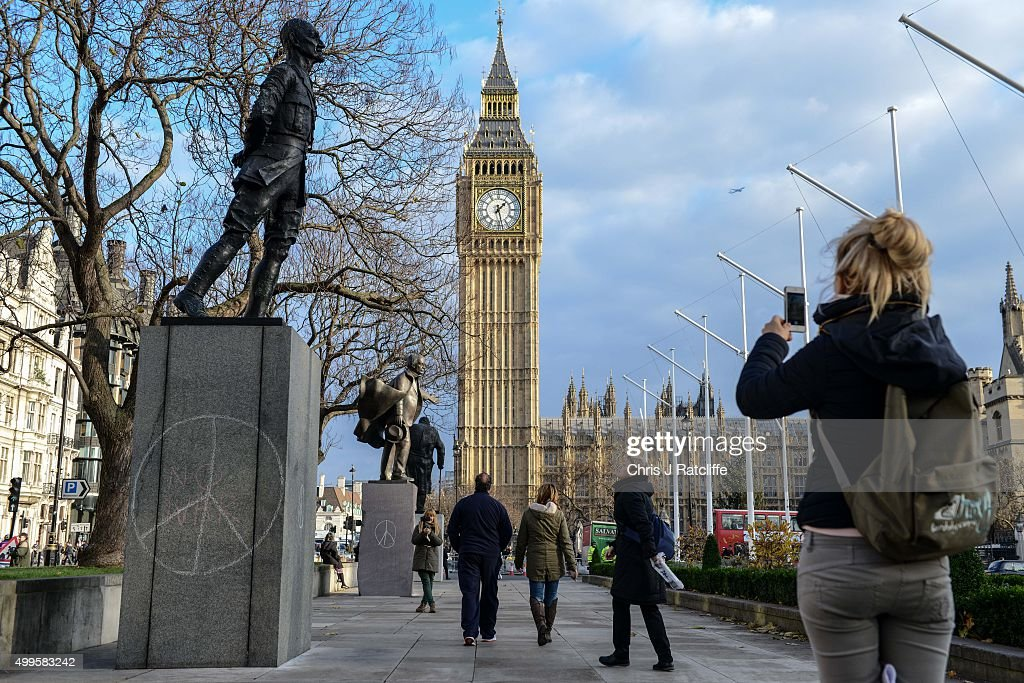 Peace symbols and 'no war' have been drawn on political sculptures of Jan Christian Smuts (nearest to camera), former prime minister of South Africa, and former British prime minister David Lloyd George in Parliament Square on December 2, 2015 in London, England. A day long debate in the House of Commons on whether Britain should become involved in airstrikes on Islamic State targets in Syria will end in a vote at 10pm tonight.