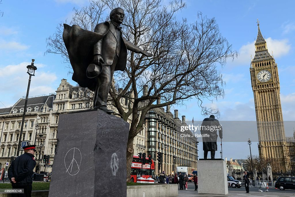 Peace symbols have been drawn on the political sculpture of former British prime minister David Lloyd George in Parliament Square on December 2, 2015 in London, England. A day long debate in the House of Commons on whether Britain should become involved in airstrikes on Islamic State targets in Syria will end in a vote at 10pm tonight.