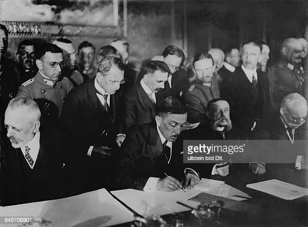 Peace treaty between Romania on one side and AustriaHungary Bulgaria Germany and the Ottoman Empire on the other signed in Bucharest Signing of the...