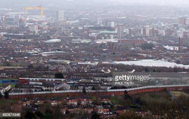 A peace wall separating the Catholic and Protestant communities is pictured in Belfast on January 25 2017 Northern Ireland will hold snap elections...