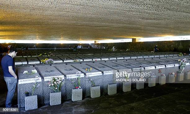 A peaceactivist watches tombs at Fosse Ardeatine monument in Rome where several of hundreds Italians had been killed during World War II 02 June 2004...