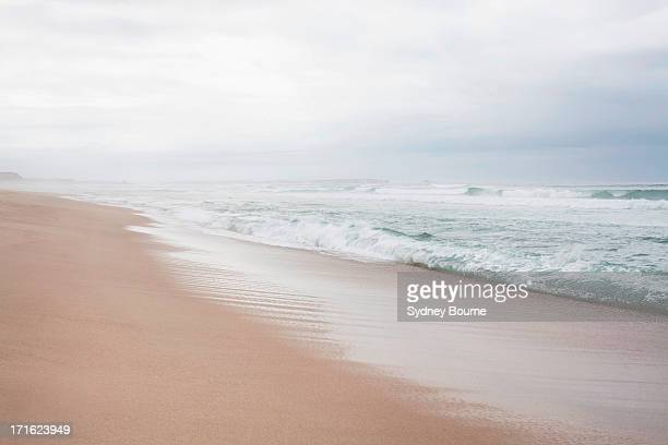 Peaceful beach scene with misty horizon