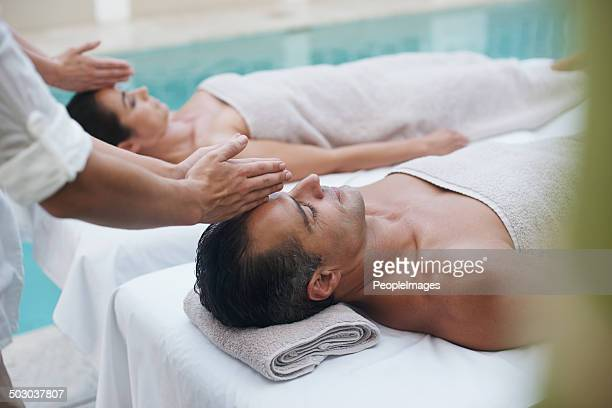 peaceful beside the one i love - husband massage wife stock photos and pictures
