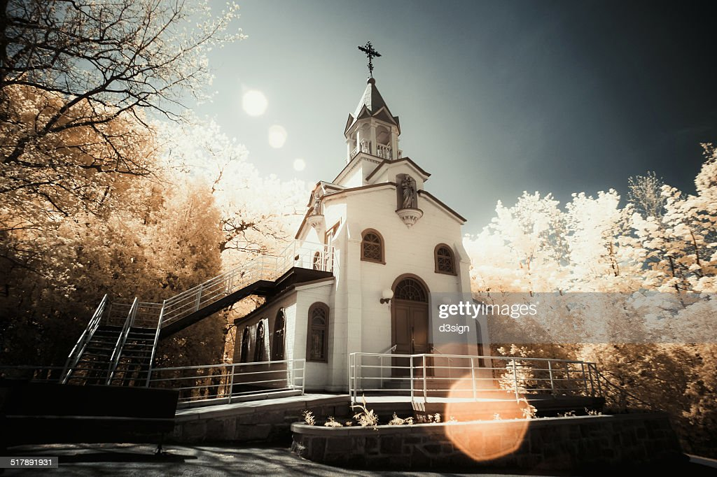 A peaceful church in white under nature sunlight : Stock Photo