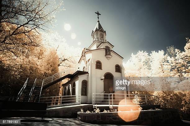 A peaceful church in white under nature sunlight