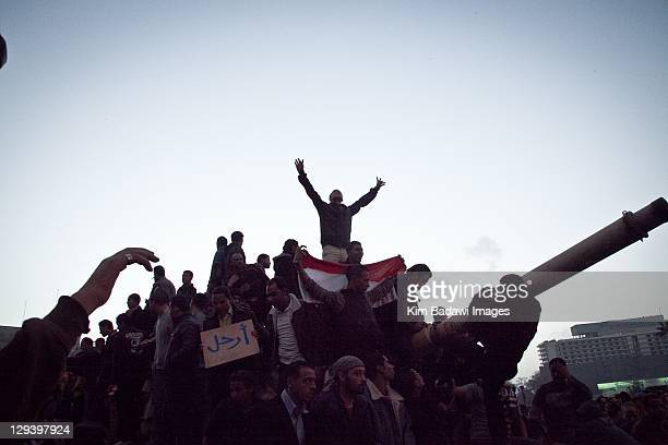 Peaceful demonstrators climb onto a Egyptian army tank in Tahrir Square on January 29, 2011 in Cairo, Egypt.