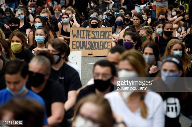 Peaceful demonstrators protesting the death of George Floyd hold up placards at the Bethesda Library on June 2 in Bethesda, Maryland. - Anti-racism...