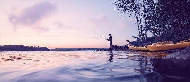 Peaceful fishing at a lake 906834606