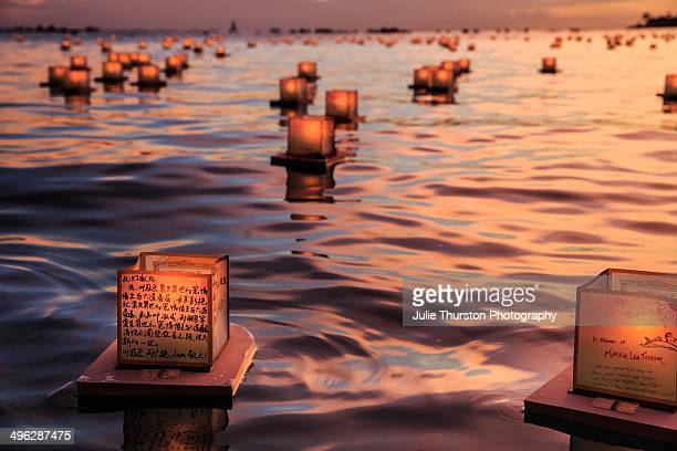 Peaceful Japanese Candlelit Floating Lanterns and Reflections at Sunset on Memorial Day at Ala Moana Beach Park Honolulu Oahu Hawaii