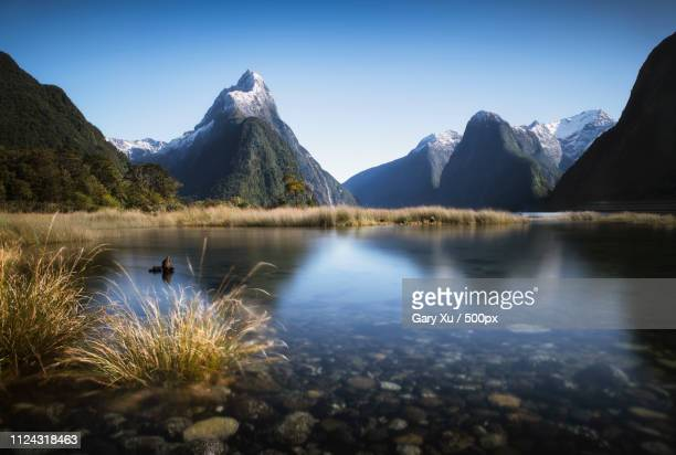 peaceful mitre - mirror lake stock pictures, royalty-free photos & images