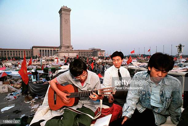 Peaceful musical protest A man plays a guitar in Tiananmen Square Prodemocracy demonstrators and protestors filled the square for weeks prior to the...